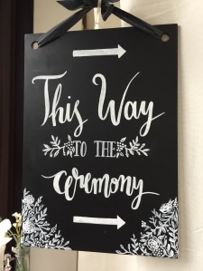 wedding sign direction this way to the ceremony chalk board vines floral