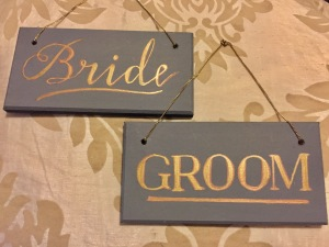 bride and groom hanging signs